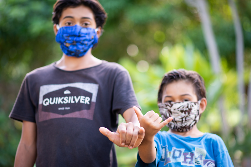 Two young boys wearing masks
