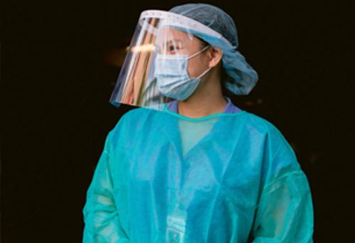 Nurse wearing scrubs and mask